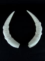 Фигурки крокодилов из кости кабана